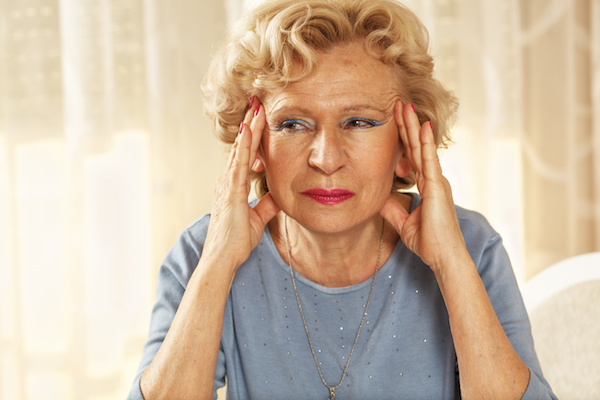 Senior woman with migraine problems.